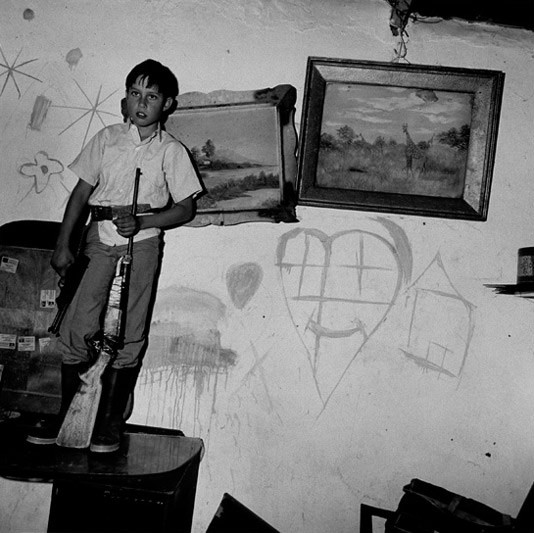 Boy with guns, Western Transvaal, 1993