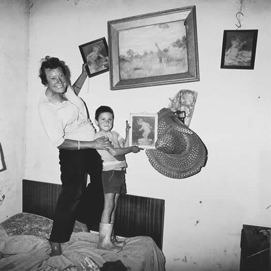 Diamond digger and son standing on bed, Western Transvaal, 1987