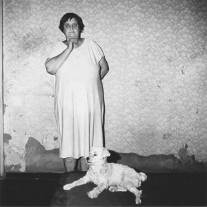 Mrs J J Joubert and dog, Dinky, in bedroom, Central Cape, 1990