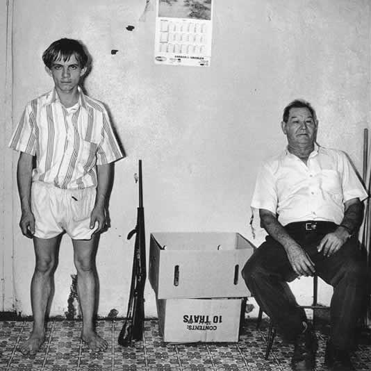 Prospectors inside house, Western Transvaal, 1987