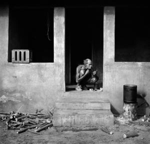 Man shaving on verandah Western TVL, 1986